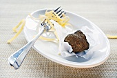 Black truffle (Perigord truffle) on paper, ribbon pasta on fork