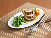 Roast loin of pork with crust and green beans