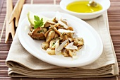 King oyster mushrooms with cheese shavings, olive oil