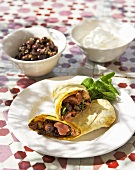 Moroccan flatbread wraps with lamb and harissa filling