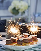 Mini burgers with sparklers