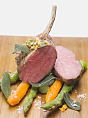 Lamb chops with carrots, asparagus and sage