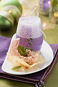 Red cabbage foam soup with Parmesan wafer and langoustines