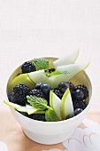 Bowl of autumn berries and pear slices