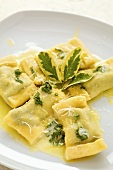 Home-made spinach ravioli in sage butter