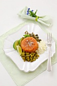 Salmon tartare with onions, gherkins, capers, lime wedges