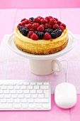 Cheesecake topped with raspberries & blackberries, computer