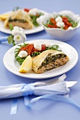 Salmon and spinach strudel with salad