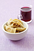Sauerkraut and mushroom pierogi, borscht in glass
