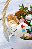 Easter eggs, Easter lamb and Easter bread in basket