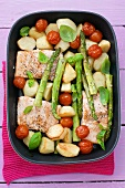 Salmon, potatoes, asparagus & cherry tomatoes in roasting dish