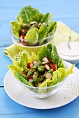 Asparagus salad with surimi and capers on a bed of lettuce