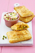 Puff pastry pasties with potato and pea filling