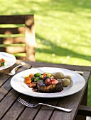 Beefsteak with shallot sauce, vegetables, potatoes out of doors