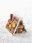 A gingerbread house with icing sugar snow