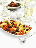 Roasted vegetables on festive table (Christmas)