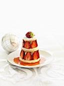 Tower of shortcake, vanilla cream and strawberries