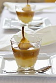 Poached pears in caramel cream