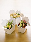 Different salads in three boxes