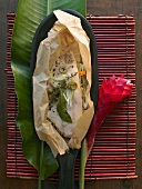Nile perch en papillote with vegetable sticks and olives