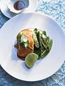 Salmon with soy sauce and maple syrup served with mangetout
