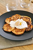 Corn and pepper pancakes with fried egg