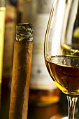 A glass of rum and a cigar
