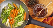 Honeyed carrots with spring onions