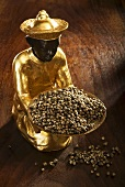 Gilded statuette with monk's pepper (Vitex agnus-castus)