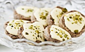 Nut biscuits with white chocolate icing and pistachios