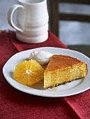 A piece of orange cake