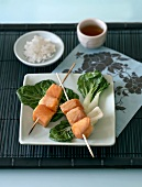 Salmon skewers with pak choi