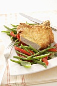 Pork chop with Parmesan crust and beans