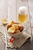 Fried cheese cubes (Appenzeller) with beer