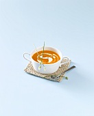 A cup of carrot and mango soup