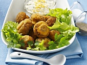 Breaded chestnut mushrooms with egg and caper sauce