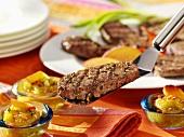 Veal steaks with peach chutney