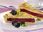 Blackberry tart with flaked almonds