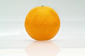 An orange with drops of water
