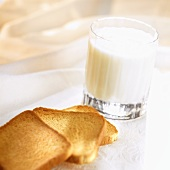 Slices of zwieback and glass of milk