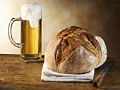 Crusty bread and glass of beer