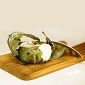 Cheese wrapped in chestnut leaves