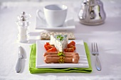 Sausages with mustard, Roquefort and tomatoes