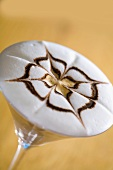 Tiramisu coffee in a glass with pattern on milk foam