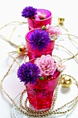 Fresh flowers and chain (table decoration)