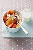 Muesli with red berries in a cup