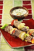 Grilled lamb kebabs with yoghurt sauce