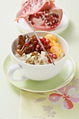 Middle Eastern rice pudding with pomegranate seeds