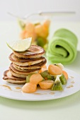 Buckwheat pancakes served with fruit salad