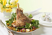 Lamb shank with potatoes, carrots and parsley for Easter